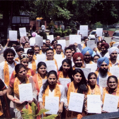 students in cheerful mood after receiving degrees