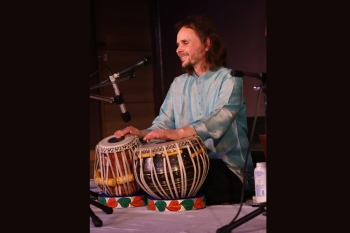 Florian playing tabla in kendra's special programme