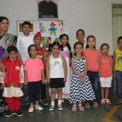 children displaying their paintings & craft