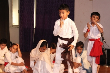 children in theatre workshop presenting a play